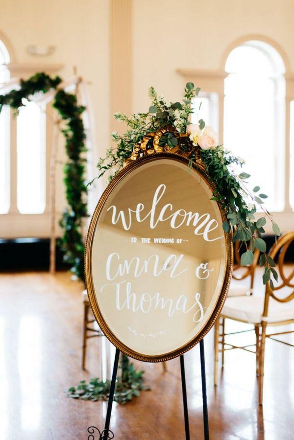 Vintage Mirror for a Calligraphy Wedding Sign Welcoming Guests | Alisha Maria Photography | http://heyweddinglady.com/modern-indoor-garden-wedding-elegant-ballroom/