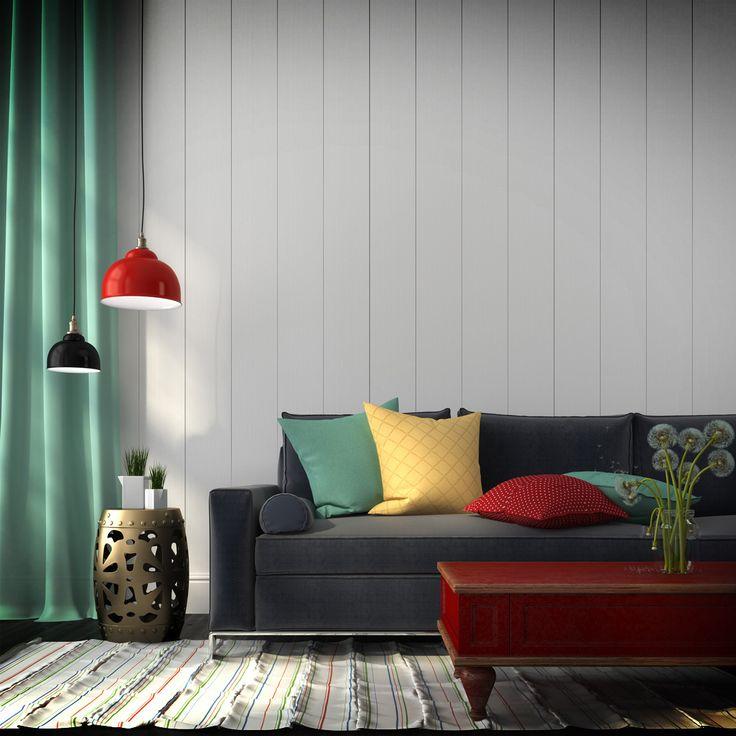 Si tus muebles son negros puedes jugar un poco más con los colores de los textiles y complementos.