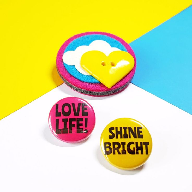 Carry your own ray of sunshine wherever you go! This colourful felt brooch comes with a choice of cheerful messages - Be Happy, Love Life OR Shine Bright! Full Description: Sunshine Brooch made from 100% wool felt Decorated with wool blend felt (30% wool, 70% viscose) glitter fabric and a yellow heart shaped button Measures approximately 5cm x 5cm Fastens with a 3cm brooch pin with safety catch Metal Pin Badge measures approximately 2.5cm&...