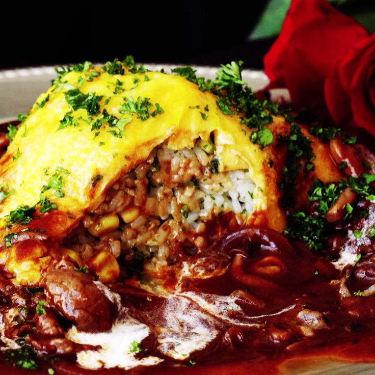 Omuhayashi is a savory rice dish topped with an omelet and robust sauce of red wine, beef and mushrooms.