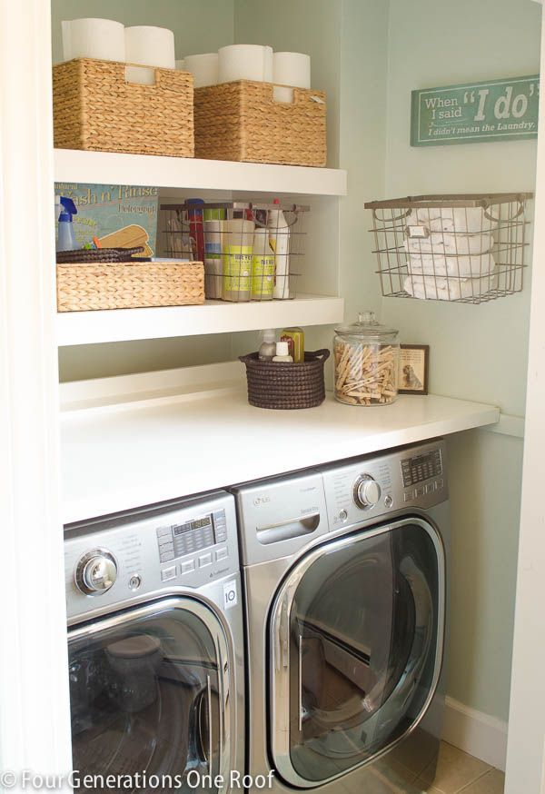 How to use sisal baskets in a laundry room for storage and create a coastal space that is pretty to wash laundry in. The green wall color also makes the space feel fresh and bright.
