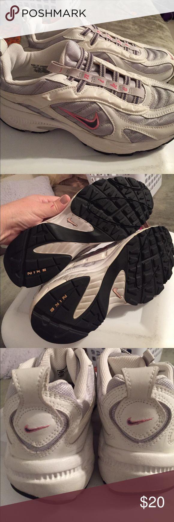 Nike slip on tennis shoes White & pink slip on tennis shoes, hardly worn Nike Shoes Athletic Shoes