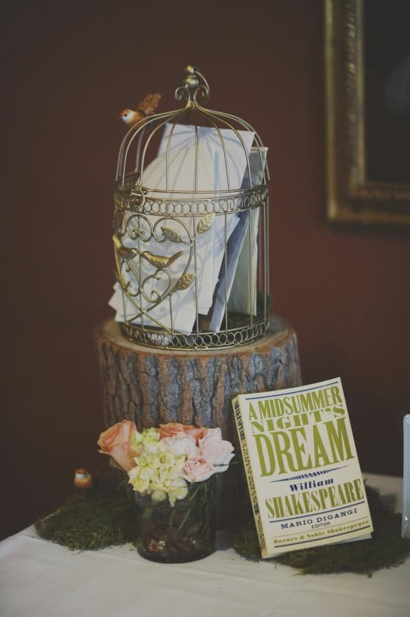 woodland themed welcome table with card basket and Shakespeare volume