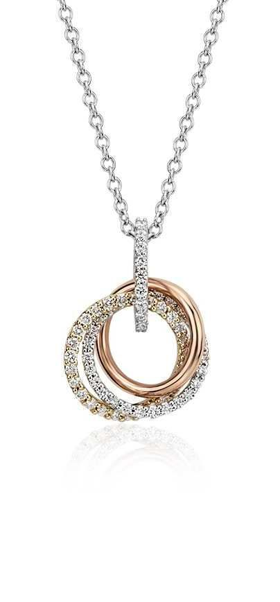 This circle diamond pendant features round diamonds in white and yellow gold accented by a rose gold ring.