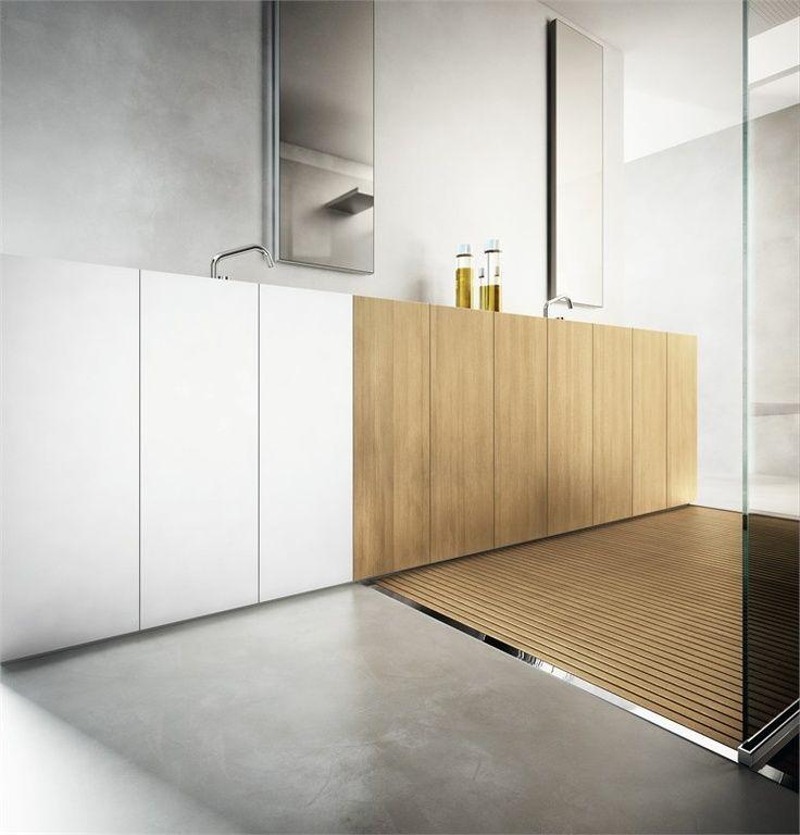 baño con lavabos integrados en los muebles, zona de ducha abierta con suelo de madera y microcemento
