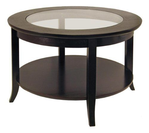 Genoa Coffee Table, Glass inset and shelf by Winsome. $149.17. Assembly Required Yes. Height 18.03. Style Transitional. Width 30. Length 30. Elegantly design with glass top, this coffee table. Its flared leg, shelf blends well with any style of room decor. Or match with same collection round side table# 92318 & end table# 92218Color BrownFinished Dark Wood