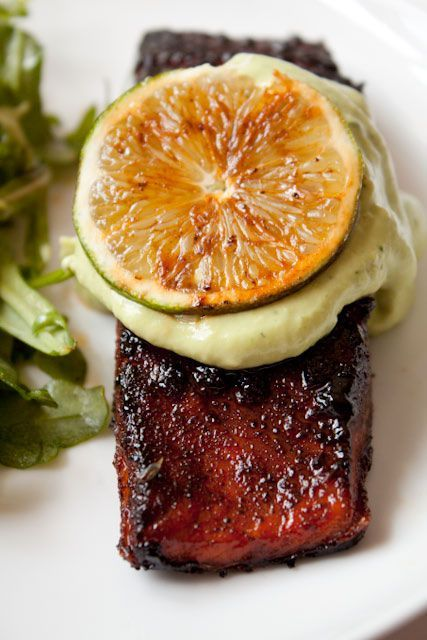 Whoa. Brown Sugar Chili Rubbed Salmon with Avocado Cream ~ ½ avocado, peeled and pitted / 2 T sour cream / 2 T lime juice (about the juice of 1 lime) / 1 garlic clove / ¼ cup fresh parsley, stemmed / ¼ tsalt For the salmon:  2 T light brown sugar / 1 T chili powder / ½ teaspoon salt / pinch cayenne pepper / 4 5-oz salmon filets / 2 T oil / 1 lime, thinly sliced into rounds