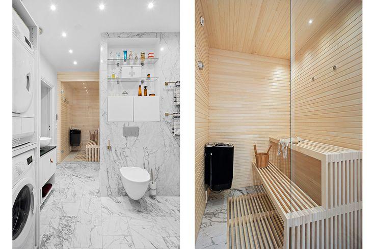 Badrum med marmor och bastu. Platsbyggd lav med virket på högkant för en sleek-look