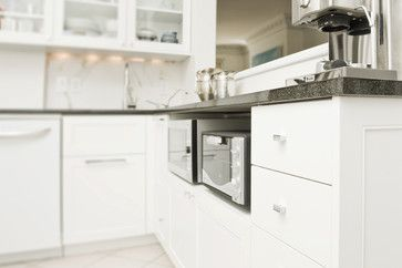 microwave & toaster oven tucked under the counter {Westmount by Laure Guillelmi}
