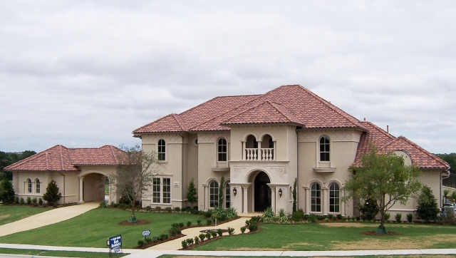 Mediterranean home with porte cochere into motor court for Porte cochere homes