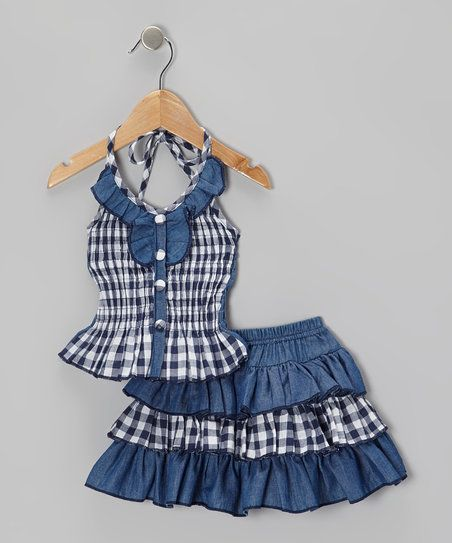 With a sweetly shirred bodice, ruffled halter neckline and flared bottom, this pretty top pairs perfectly with its matching tiered skirt. Soft cotton construction means this denim delight is as comfy as it is charming.