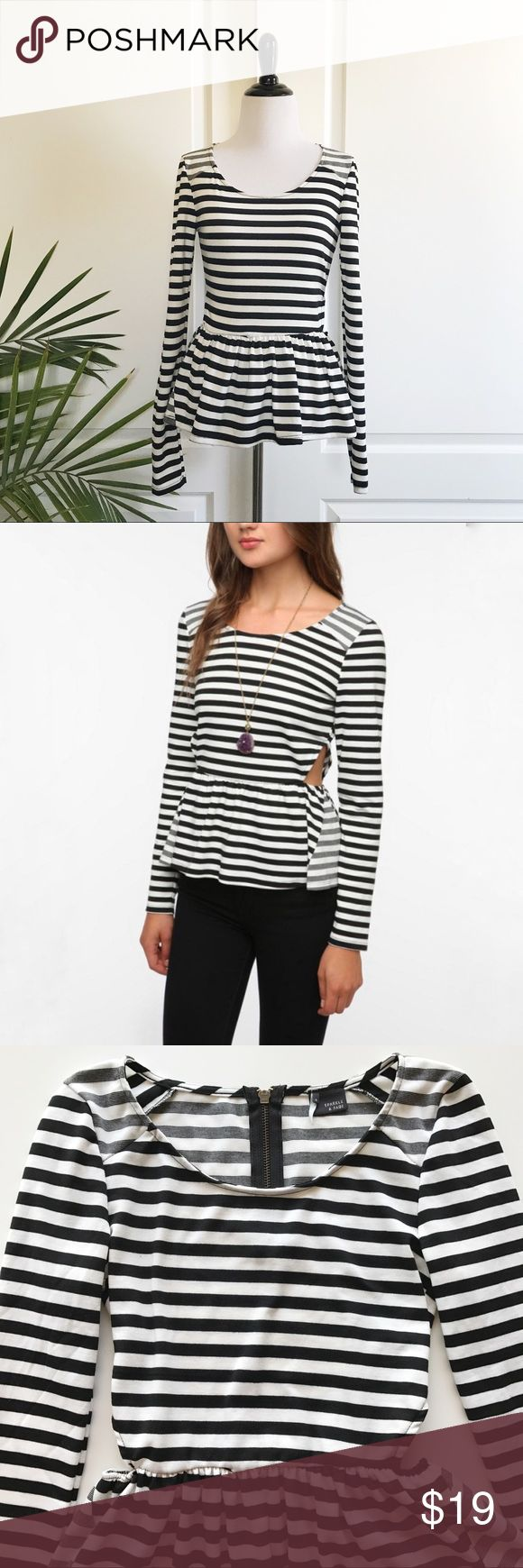 "Urban Outfitters Striped Side Cutout Peplum Top UO Sparkle and fade striped side cutout peplum top *Size Small - Underarm to underarm : 15"" flat / Waist : 12.5"" flat (elastic) / Length : 25"" *Long sleeves / Side cutouts / Black and white stripes / Made in USA  *97% polyester and 3% spandex  *New without tags *No trade G Urban Outfitters Tops"