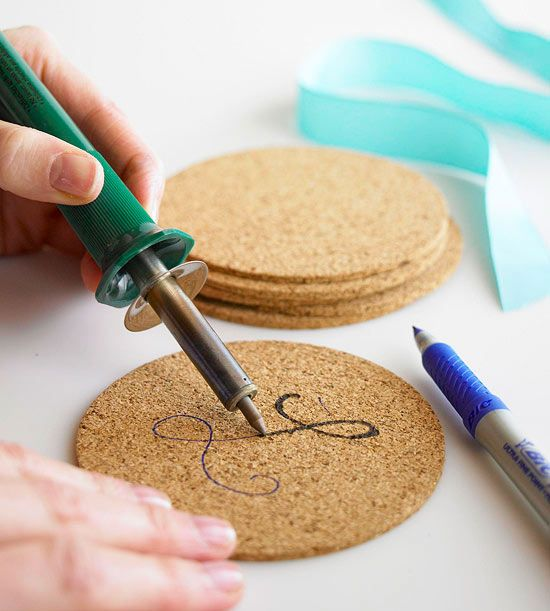 How-To: Cork Coasters  With a pen, lightly sketch a design on a cork coaster (we used a monogram and simple patterns). Use a woodburning tool to trace the design. Tip: Cork burns quickly and its smooth texture makes woodburning a snap!