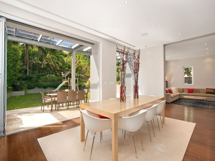 Modern dining room idea with floorboards & floor-to-ceiling windows - Dining Room Photo 481081