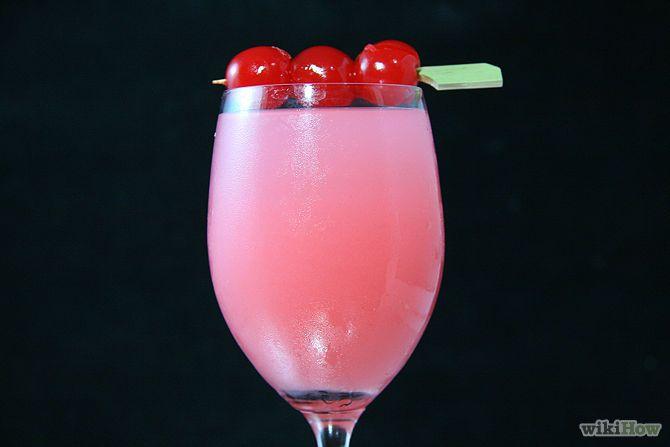 MIMOSA HERMOSA (Champagne ou Prosceco à part égale avec du jus de goyave - Décor : cerises au marasquin)