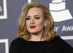 Beautiful. Sending valentines love to Karl Lagerfeld who recently called Adele fat. Obviously the man never got enough hugs. She looks fab as always.