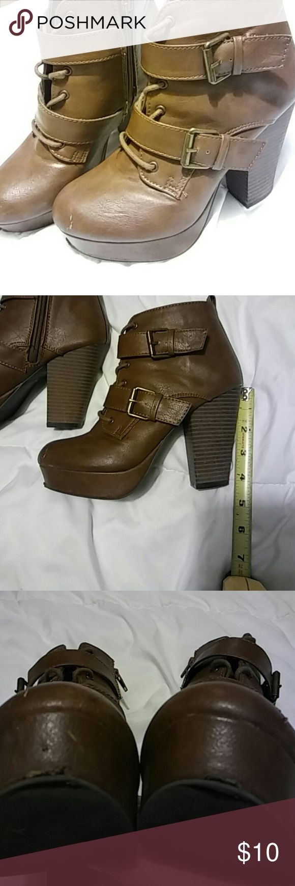 Brown Booties Size 7, 4 in heel brown booties! Minor scuffs and minor damage to the bottom of the toe part (pictured) Otherwise in good condition. Report Shoes Ankle Boots & Booties