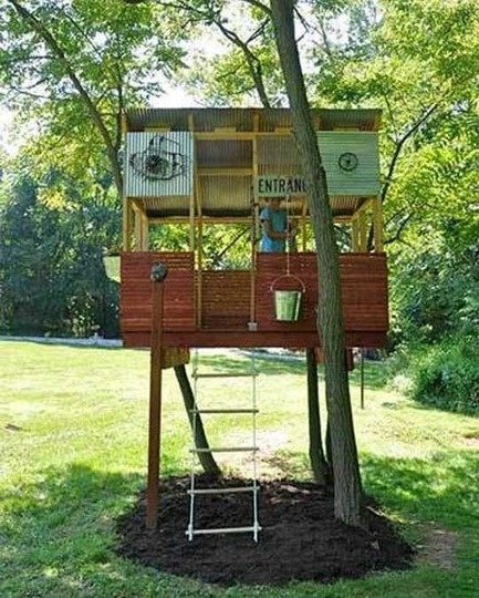 Cubby house with rope ladder, bucket on pulley.