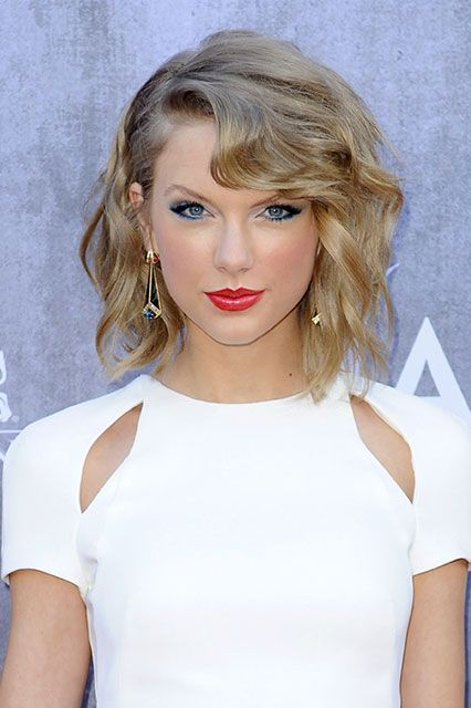 20 Different Ways Taylor Swift Has Worn Red Lipstick #refinery29  http://www.refinery29.com/2014/11/78055/taylor-swift-red-lipstick-looks#slide-17  This wasn't Taylor's typical bright red: It had a brick feel to it, but not with too much color payoff. For a similar vibe, apply a thin layer of NARS Audacious in Marlene with a lip brush.