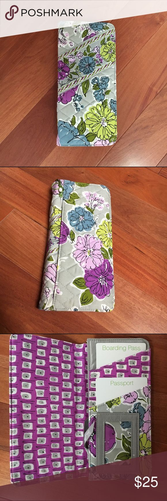Vera Bradley Travel Wallet Vera Bradley Travel Wallet in Watercolor. Inside has a spot for your ID, passport and boarding pass. Also has spot for cash and other important documents. Magnetic close Vera Bradley Bags Travel Bags