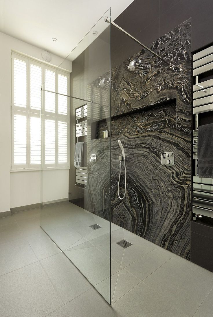 Get the look of a luxurious spa with a walk-through shower. Stunning marble brings a splash of natural beauty to this contemporary bathroom while a flush-fit showertray creates a seamless finish.