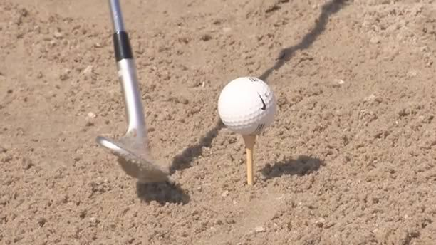 Having trouble making solid contact out of the sand? Martin Hall shows a simple drill to help you vastly improve your bunker play. Visit swingfix.golfchannel.com to get your custom instructional video tips!