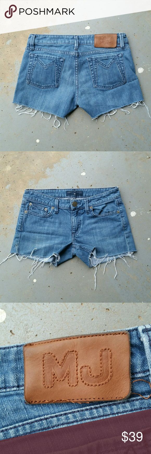 """MARC JACOBS CUT OFF JEAN SHORTS Marc Jacobs cut off jean shorts. 98% cotton. 2% elastane. 26"""" waist.  7"""" rise.  2.5"""" inseam. Bottom of back leather tag is loose.  (#546) Marc by Marc Jacobs Shorts Jean Shorts"""