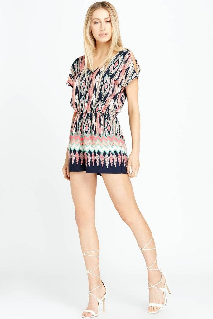 Casual weekend outfits don't have to be boring—try a loose-fitted romper with a cool print...like this one! This romper features short dolman sleeves with slit shoulders and an elasticized waistline. #PoshSquareStyle