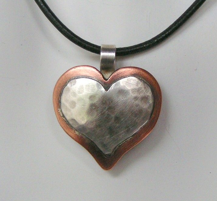I enjoy doing custom work - but I hate when I mess it up! A few months ago, I made a simple heart pendant with the name of a friends daughter stamped into the surface. I started in the middle to ce...