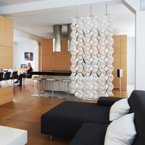 Design room divider divides kitchen and living room.