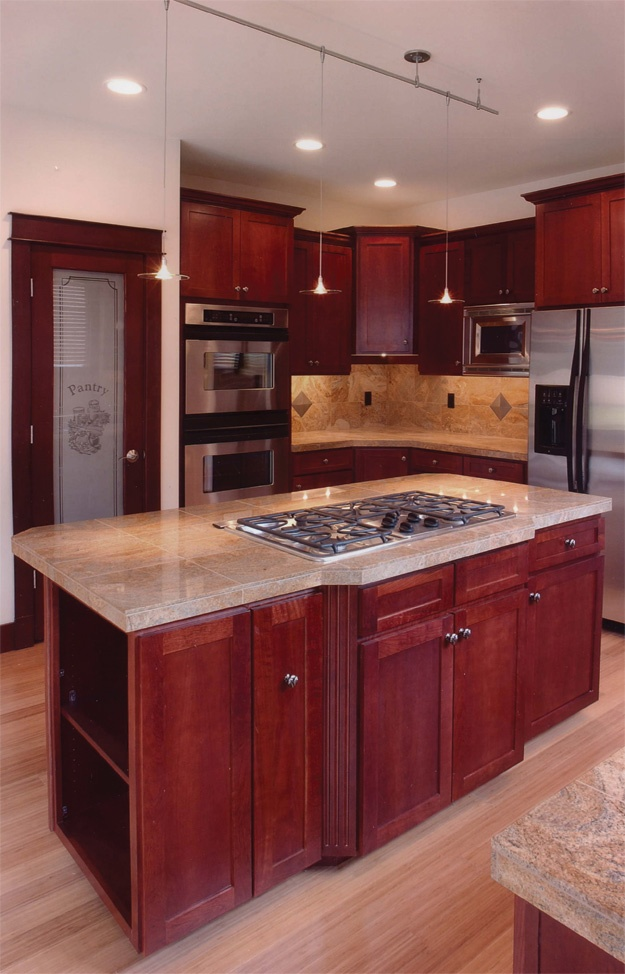 Lovely Center Island With Cooktop And Large Pantry In This Kitchen.  Craftsman House Plan #