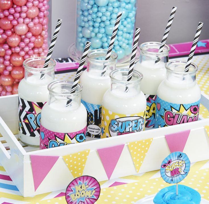 Add a little something extra to your daughter's Superhero Girl birthday party with these free printables. Use them as wrappers for bottles or jars to dress up your party drinks.