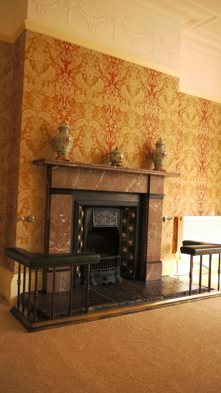 Wearholme - Marbled fire place Edwardian/Victorian. Wallpaper - laura ashley Connemara cinnamon. Lincrusta adam frieze. Fire side fender seat - brass and leather