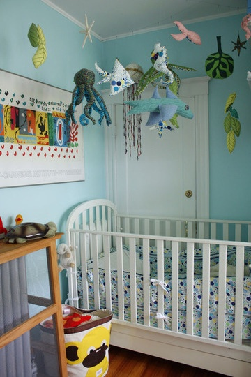 Hanging ocean themed stuffies from the ceiling on fishing line in a