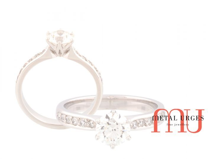 Round brilliant cut GIA certified white diamond engagement ring.  The central diamond is six claw set in platinum with grain set round white diamond shoulders.  Proudly hand made in Tasmania.