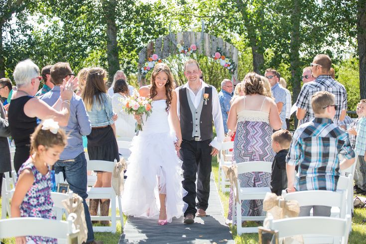 Their wedding day could not have been more perfect. The weather was  amazing, not a cloud in the sky and the decor for their outdoor ceremony  was amazing! It was obvious that a lot of thought and attention to detail had gone into  the planning, everything from drinks and fans for the guests to lawn games  and amazing food - not to mention the gorgeous arch for the ceremony. Congratulations you two!! Thank you for choosing us to be part of your day!