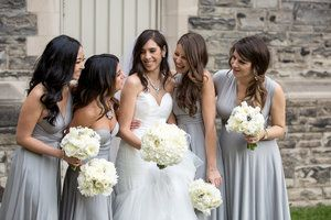 Bride and bridesmaids in silver dresses. White bouquets. Knox college wedding, University of Toronto.  Photography by Sweetheart Empire Toronto Wedding Photographer. #sweetheartempire