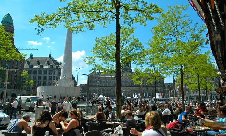 Watching people from all over the world at Dam Square.