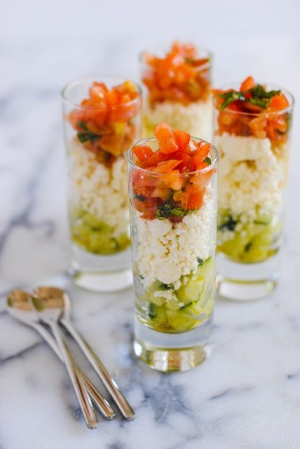 Feta Salad Shooters - layers of crunchy cucumber, tangy feta cheese, and fresh tomato and basil. A perfect, simple party bite for the summer...