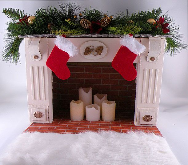 Easy to create a lifelike DIY Faux Fireplace from reused household items that looks so real it will WOW your friends. Use flamelesss candles for the inside.