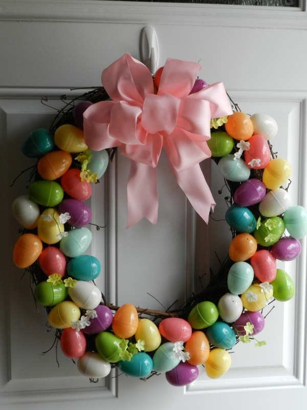 a wreath + a bag of plastic eggs + a hot glue gun + a ribbon (to make the bow)  +  a Sunday afternoon = Easter Wreath angelamccotter
