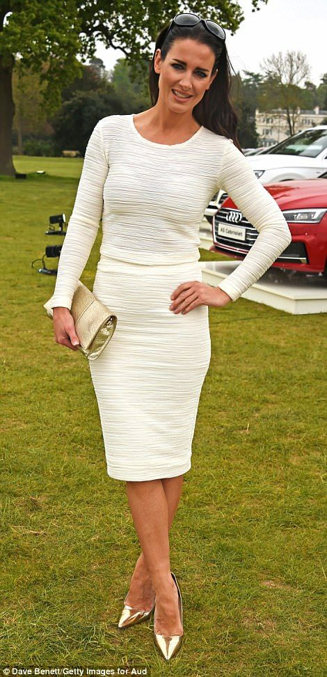 Glamour: Kirsty Gallacher cut a demure figure in a fitted white dress with metallic heels...