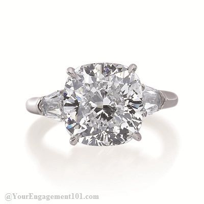 Armadani cushion three stone diamond engagement ring featuring tapered baguettes diamonds