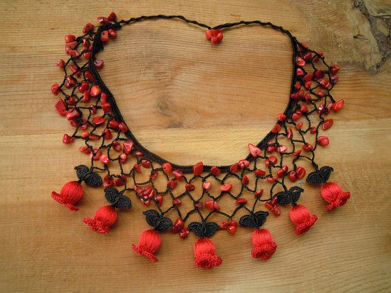 crochet bib necklace black red by PashaBodrum on Etsy - the flowers are worked around beads
