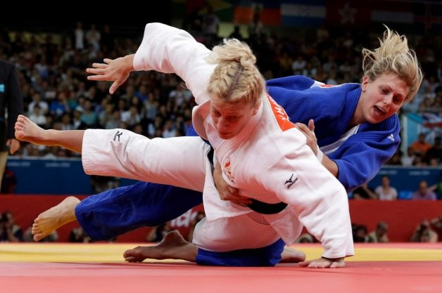 Kayla Harrison of the United States (in white) competes against Gemma Gibbons of Great Britain for the gold medal during the women's 78-kg judo competition at the 2012 Summer Olympics, Thursday, Aug. 2, 2012, in London.  Harrison won the gold and Gibbons won the silver. Photo: Paul Sancya / AP