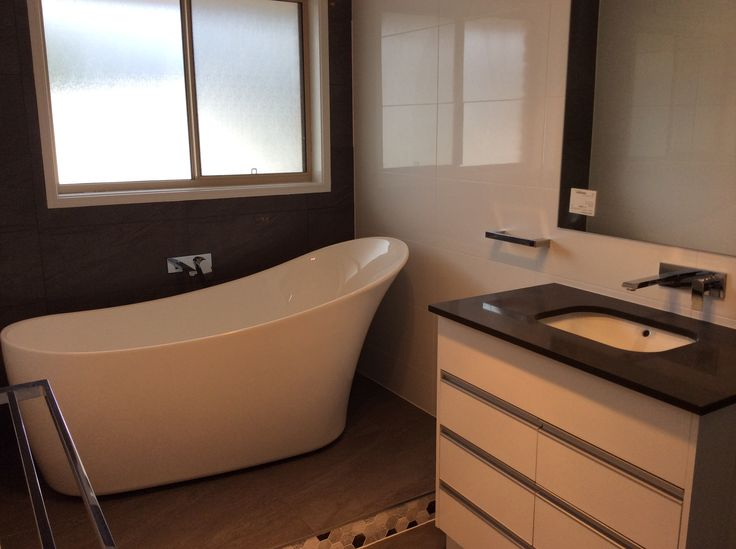 New plumbing for the free-standing bath, shower and vanity in this bathroom renovation. www.connectedplumbgas.com.au