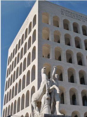 Fu progettato per essere inserito nello scenario dell'esposizione universale romana del 1942. La sua costruzione iniziò nel 1938, fu inaugurato incompleto nel 1940, per poi essere ultimato nel dopoguerra.   L'edificio appare come un parallelepipedo a quattro facce uguali, con struttura in cemento armato e ricoperto interamente in travertino, presenta 54 archi per faccita e in ragione di ciò è stato ribattezzato dai roman