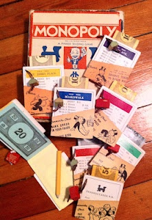 Upcycled handmade notepads made   from vintage Monopoly game   pieces by Stein Your Florist Co.