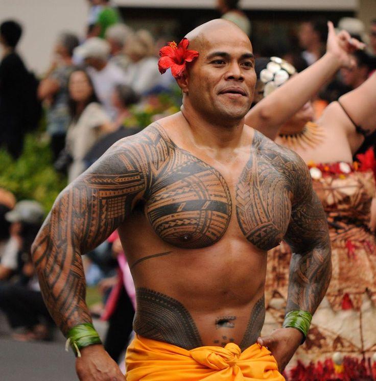 Samoan man showing his native tattoo.