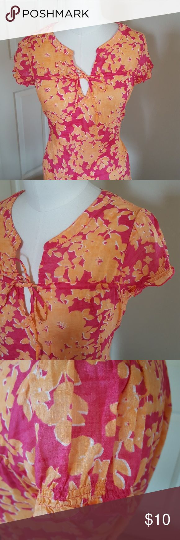 Bright floral smock top Hot pink with sunny orange floral patterned top. Short sleeve with elastic detaining at cuff/hem. Split v-neck with tie. Small gathered detail in back at nape of neck. Super light, gauzy cotton. Old Navy Tops